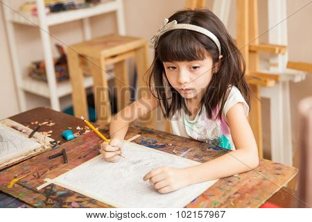 Thoughtful Girl Drawing For Art Class