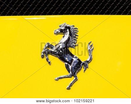 Logo Of Ferrari On Yellow Super Sport Car