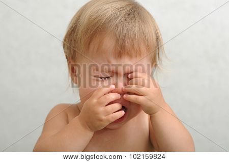 Crying Baby Rubbing Her Eyes