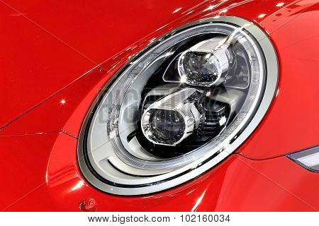 Headlight Of Porsche Red Sport Car Series 911 Carrera 4Gts