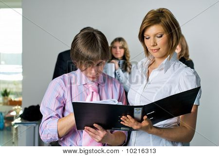 Woman and man in office