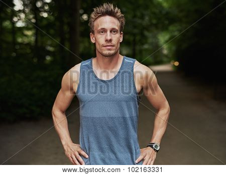 Athletic Man At The Park With Hands On Waist