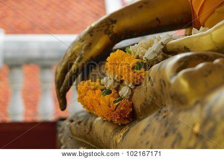 Garland On Hand Of Buddha Statue