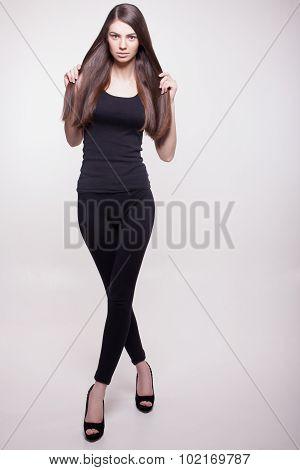 Full Growth Snapshot Of Long Hair Model In Studio
