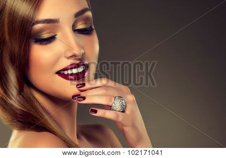 Luxury fashion style, nails manicure, cosmetics ,make-up .beautiful   teeth    white smile , earring