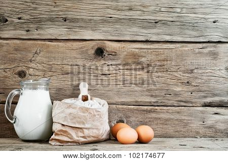 Flour In A Paper Bag With Eggs And Milk
