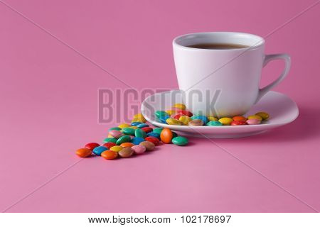 Tea Cup With Colored Sweet Dragees On Saucer