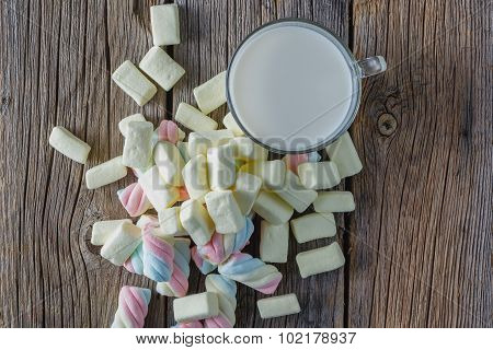 Colored Marshmallow With Milk On Wooden Table