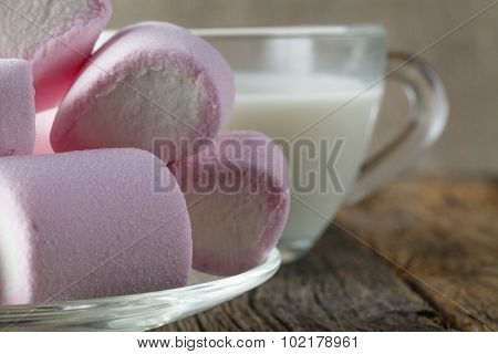 Pink Marshmallow With Milk On Wooden Table