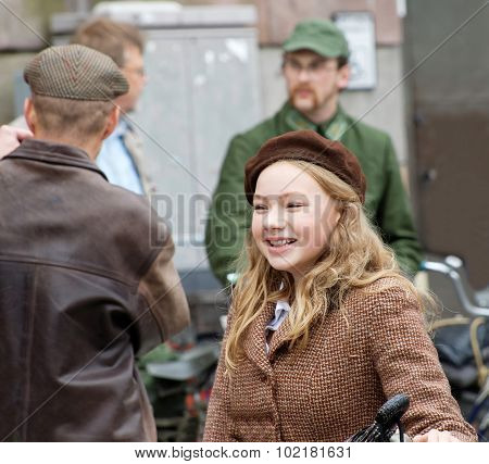 Young Girl Wearing Old Fashioned Tweed Clothes