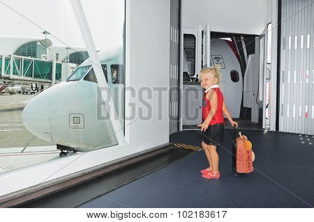 Baby Walks For Boarding To Flight In Airport Departure Gate