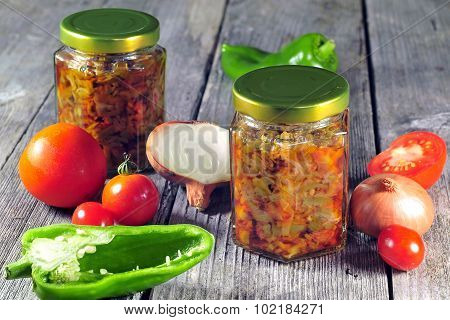 Sauted Onions, Tomatoes And Peppers Stored In Glass Jars For Winter