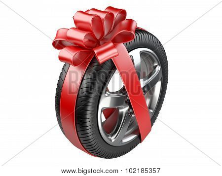 Tyre With A Wrapped Red Ribbon.