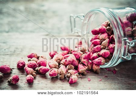 Rose Buds In Glass Jar. Selective Focus.