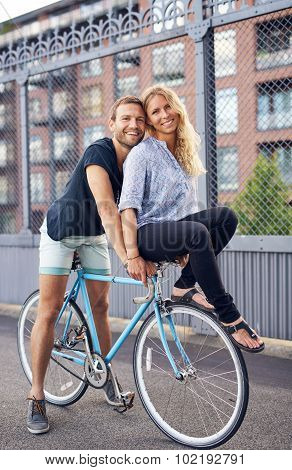 Loving Couple Riding Bikes