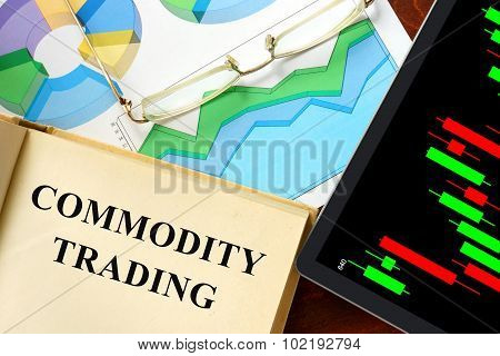 Word commodity trading written on a book.