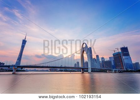 cable stayed bridge over a river at dusk