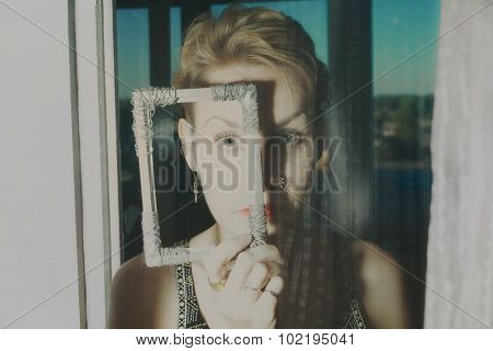 Young Woman Behind Transparent Glass
