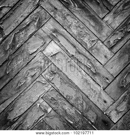 Aged parquet pattern closeup background.