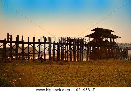 Amarapura, Myanmar - 14 March 2015: People Walking On The Wooden Bridge Of U Bein On River Ayeyarwad