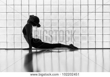 Young woman practicing in a yoga studio. Upward facing dog during sun salutations.