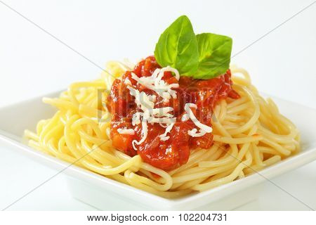 detail of spaghetti with bolognese sauce sprinkled with grated cheese
