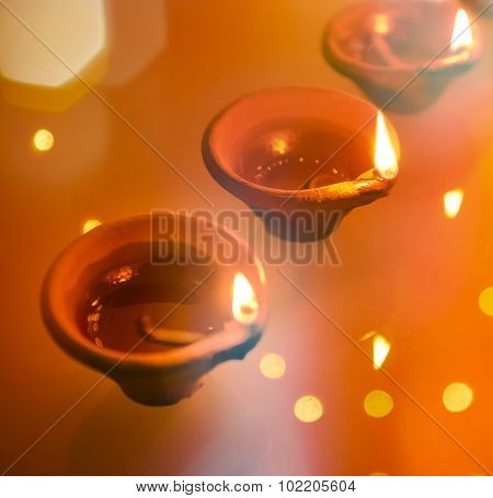 An abstract and colorful Diwali Greeting card background.