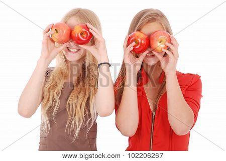 Two Girls Hold Near Eyes Fresh Apples