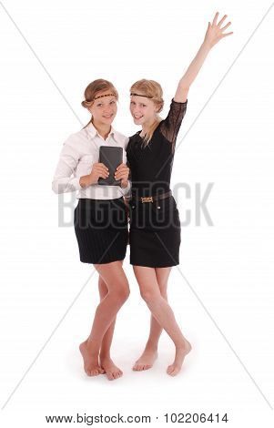 Girls Holding Tablet Pcs Lifting Arm