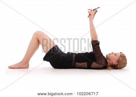 Girl Is Looking At Tablet Pc While Lying