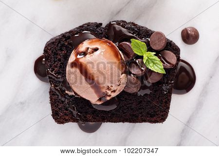 Chocolate loaf cake slice on a marble board