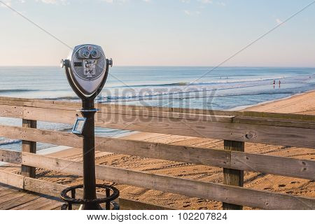 Sightseeing Binoculars on Pier with Beach Background