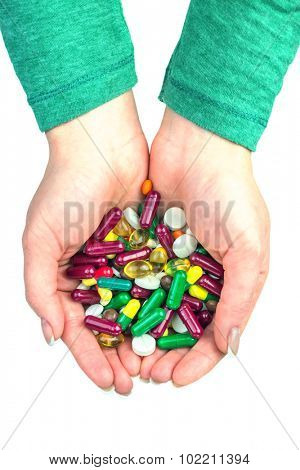 many color pills in hand isolated