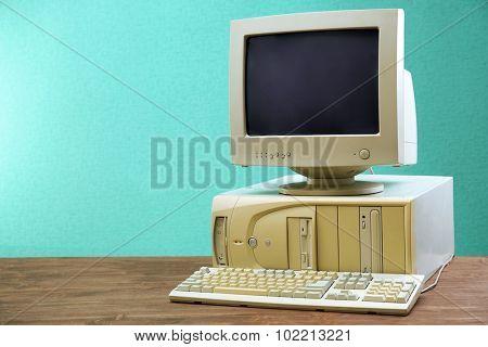 Obsolete computer set on light blue background