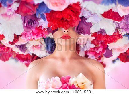 Portrait of a brunette lady in flowers