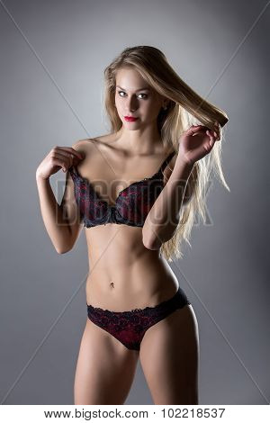 Sexy model posing in lingerie black and red colors