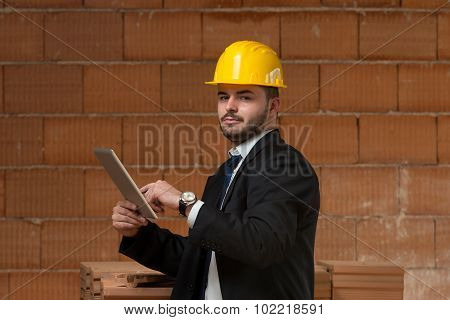 Caucasian Male Construction Manager With Tablet Pc