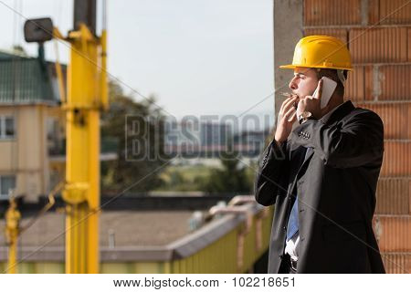 Businessman Talking On Phone And Smoking A Cigar