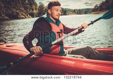 Kayaker with paddle on a boat