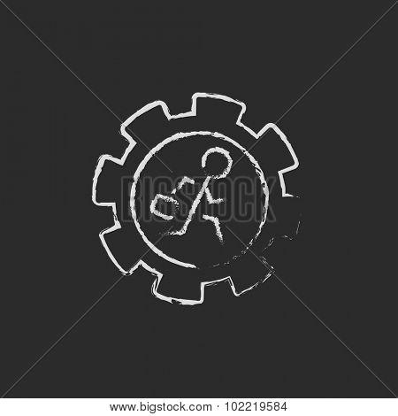 Man running inside the gear hand drawn in chalk on a blackboard vector white icon isolated on a black background.