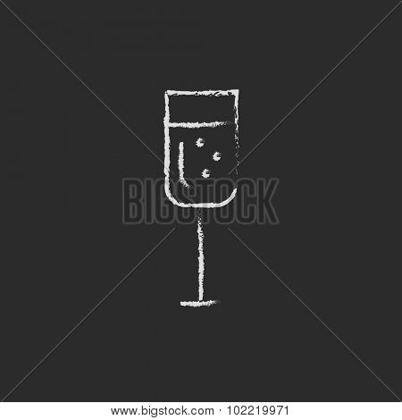 Glass of champagne hand drawn in chalk on a blackboard vector white icon isolated on a black background.