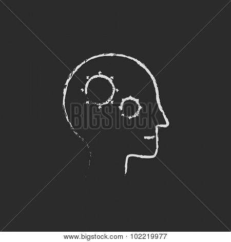 Human head with gear hand drawn in chalk on a blackboard vector white icon isolated on a black background.