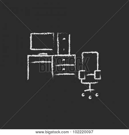 Computer set with table and chair hand drawn in chalk on a blackboard vector white icon isolated on a black background.