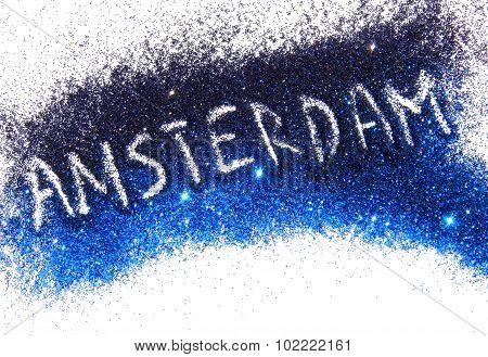 Inscription Amsterdam on black and blue glitter sparkles on white background