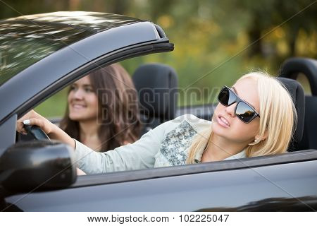 Young Woman Focusing On Driving