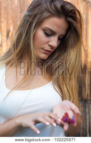 Beautiful teenage girl holding butterfly