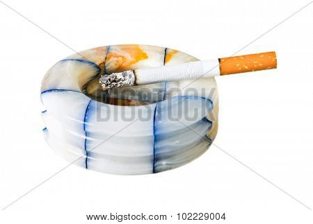 cigarette and ashtray isolated on white