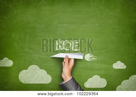 ROE  concept on blackboard with paper plane