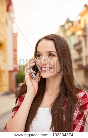 Happy Girl Talking On The Phone On The Street
