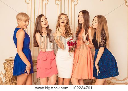 Bride Showing Off Her Ring To Her Friends